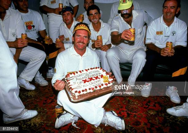 Allan Border of Australia celebrates his world record for the number of test runs during the 1st Test Match between New Zealand and Australia 1993 in...