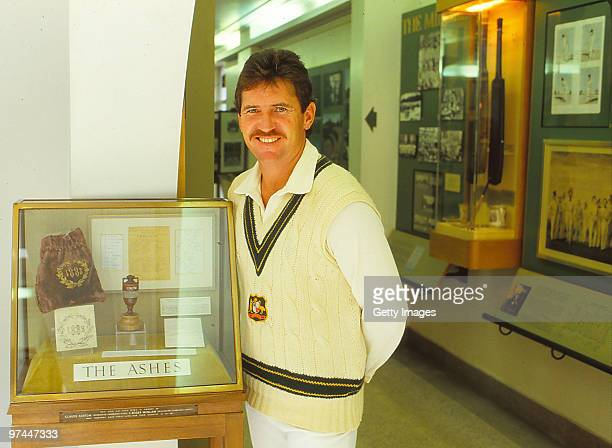 Allan Border of Australia poses with the Ashes in Australia