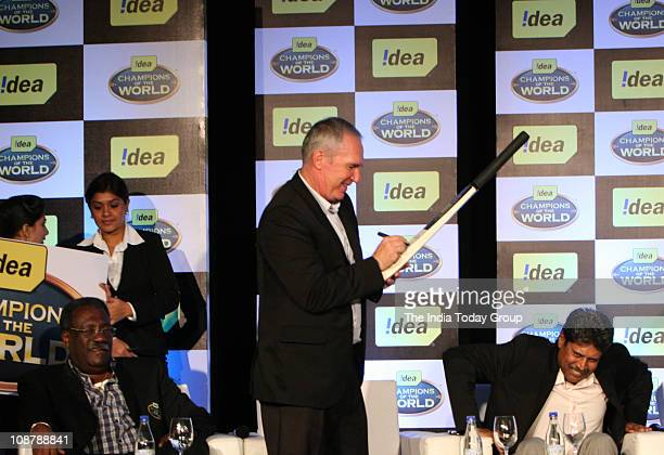 Allan Border signs the bat during the 'Keep Cricket Clean' function in Mumbai on February 2