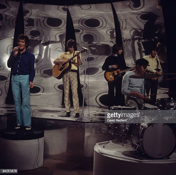 Allan Clarke Graham Nash Tony Hicks Bobby Elliott and Bernie Calvert of The Hollies perform on a BBC Television show in 1967