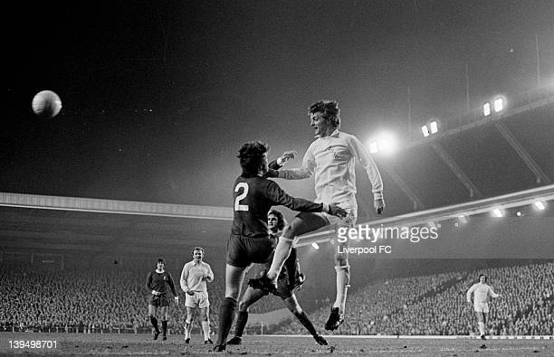 Allan Clarke of Leeds leaps high above Chris Lawler of Liverpool in front of Larry Lloyd and Billy Bremner during the League Cup fourth round match...