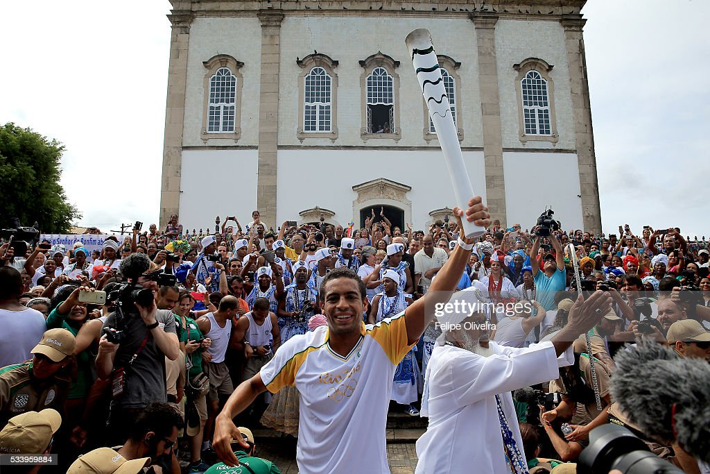 Allan do Carmo of Brazil, aquatic marathon athlete, and Filhos de Gandy on May 24, 2016 in Salvador, Brazil.