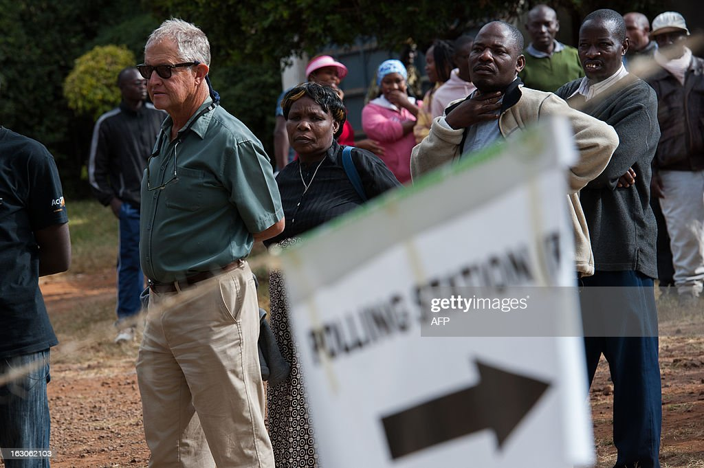 Allan Earnshaw, a white Kenyan whose family has been in Kenya since 1896, queues to vote in the Langata constituency of Nairobi on March 4, 2013 during the Kenyan elections. Earnshaw first voted in 1974, and says 'It's the first time we've had a proper Kenya constitution [to vote under], not some thing that was cobbled together by the British.' The tense elections are seen as a crucial test for Kenya, with leaders vowing to avoid a repeat of the bloody 2007-8 post-poll violence in which over 1,100 people were killed, with observers repeatedly warning of the risk of renewed conflict. 'I think everyone was shocked by what happened last time - I was shocked; by and large it's a peaceful country. With a turnout like this we might even get a winner in the first round.' Voters turned out in massive numbers queued from before dawn to register their vote.