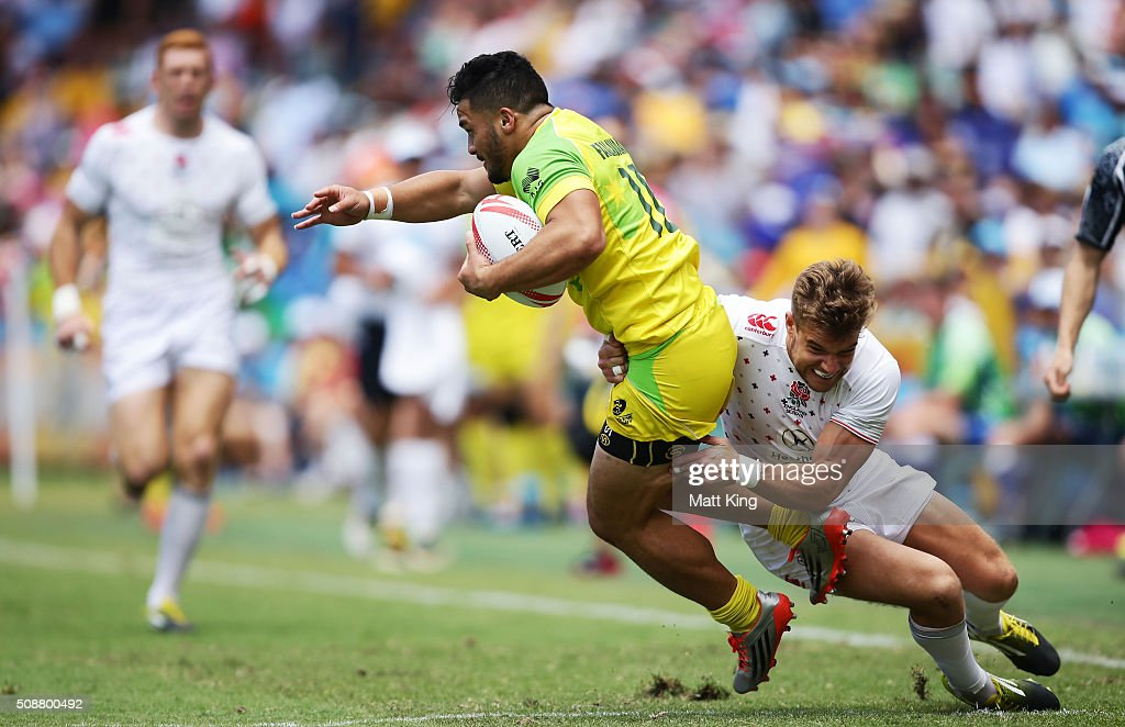 Allan Fa'alava'au of Australia is tackled during the 2016 Sydney Sevens Cup Quarter Final match between England and Australia at Allianz Stadium on February 7, 2016 in Sydney, Australia.