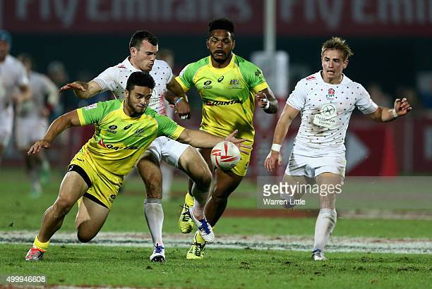 Allan Fa'Alava'au of Australia wins the lose ball against England during the Emirates Dubai Rugby Sevens HSBC World Rugby Sevens Series at The Sevens...
