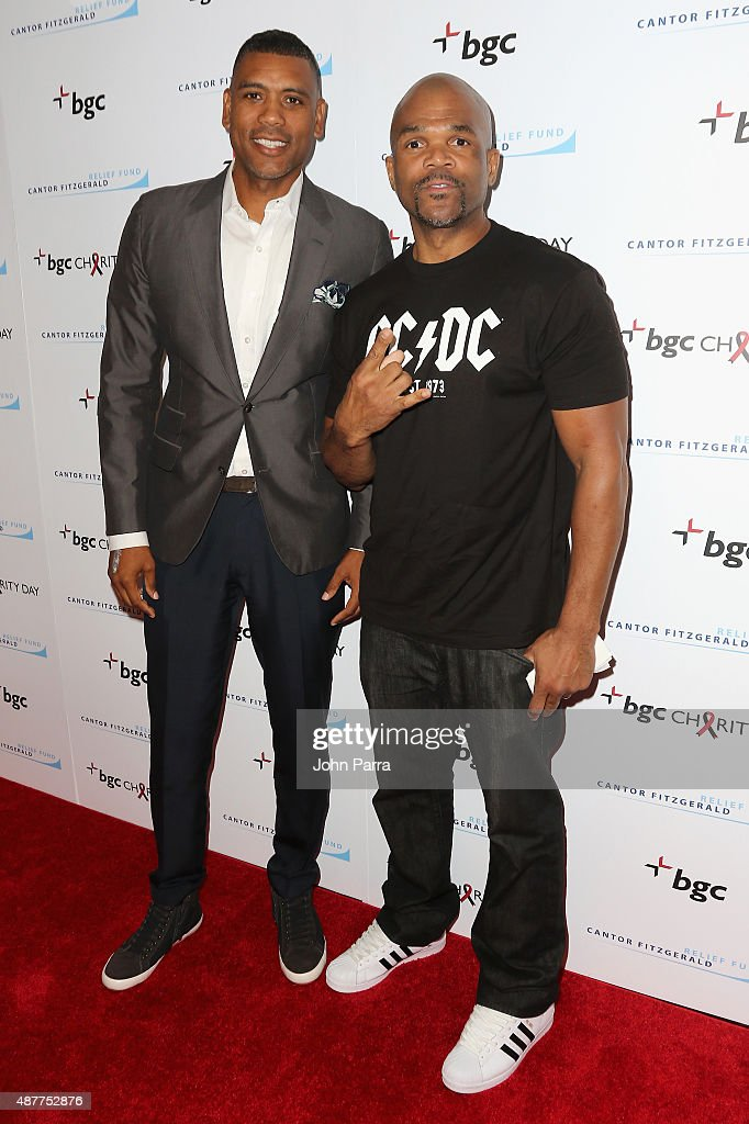 Allan Houston and Darryl 'DMC' Matthews McDaniels attend Annual Charity Day hosted by Cantor Fitzgerald and BGC at BGC Partners INC on September 11...