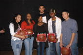 Allan Houston of the New York Knicks poses with winners of the Knicks Poetry Slam series at Christopher Columbus High School on February 4 2004 in...