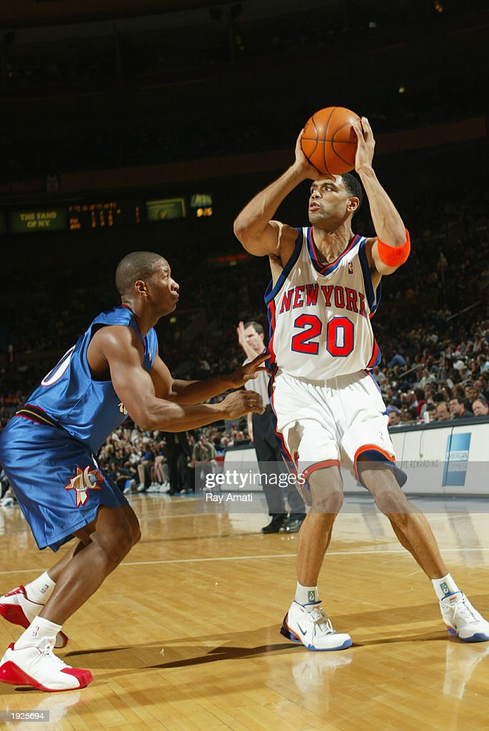 Allan Houston #20 of the New York Knicks shoots against Eric Snow #20 of the Philadelphia 76ers on April 11, 2003 at Madison Square Garden in New York, New York.