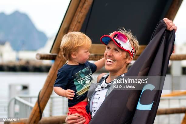 Allan Hovda wins the race with his son on his arm at The Arctic Triple // Lofoten Triathlon Extreme distance on August 19 2017 in Svolvar Norway...