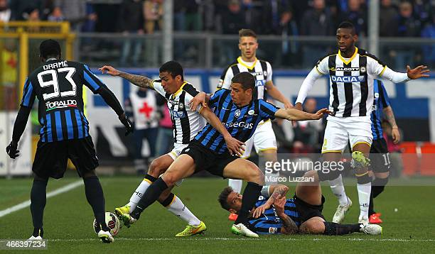 Allan Marques Loureiro of Udinese Calcio competes for the ball with Carlos Carmona of Atalanta BC during the Serie A match between Atalanta BC and...