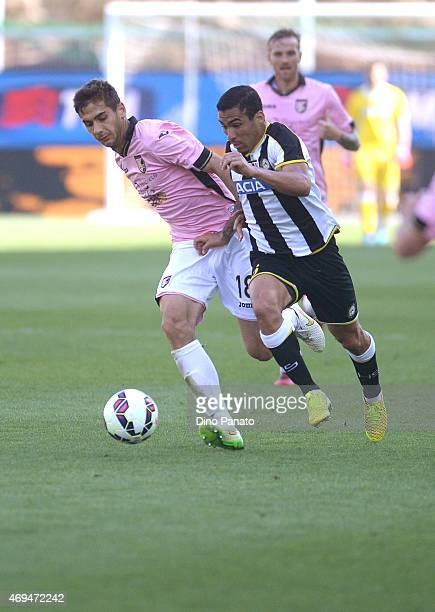 Allan Marques Loureiro of Udinese Calcio competes withIvajlo Chocev of US Citta di Palermo during the Serie A match between Udinese Calcio and US...