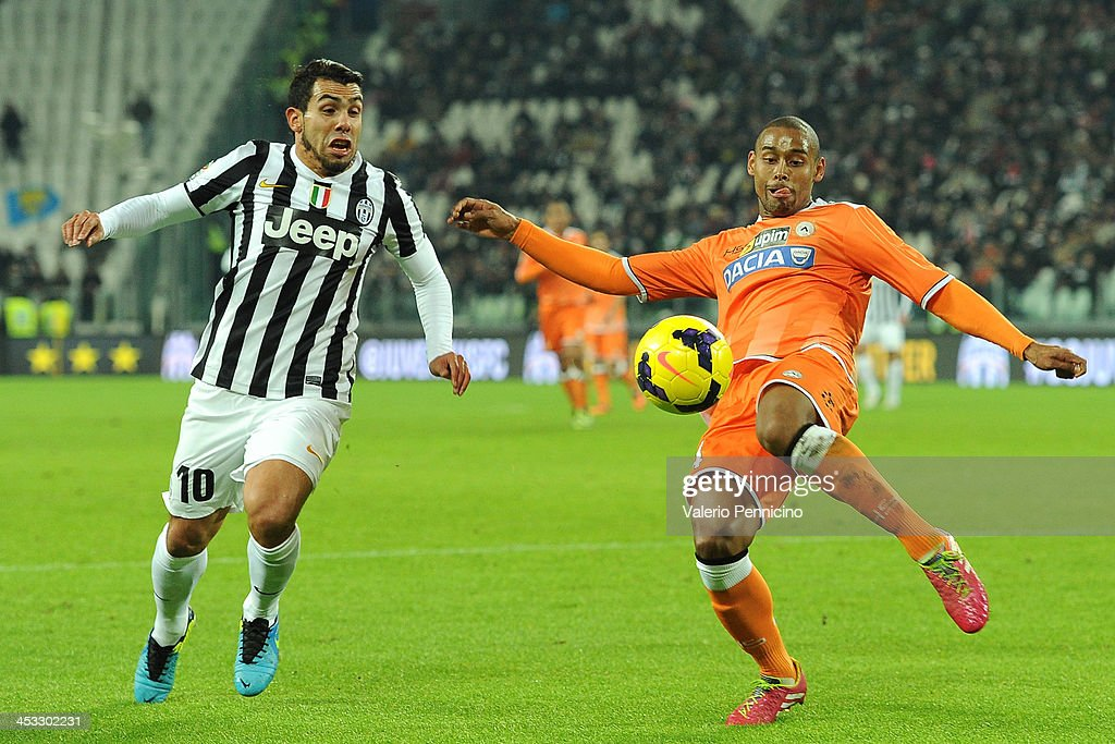 Allan Marques (R) of Udinese Calcio in action against Carlos Tevez of Juventus during the Serie A match between Juventus and Udinese Calcio at Juventus Arena on December 1, 2013 in Turin, Italy.