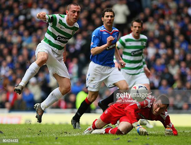Allan McGtregor of Rangers is tackled by Scott Brown of Celtic during the Scottish Premier League match between Rangers and Celtic at Ibrox Stadium...