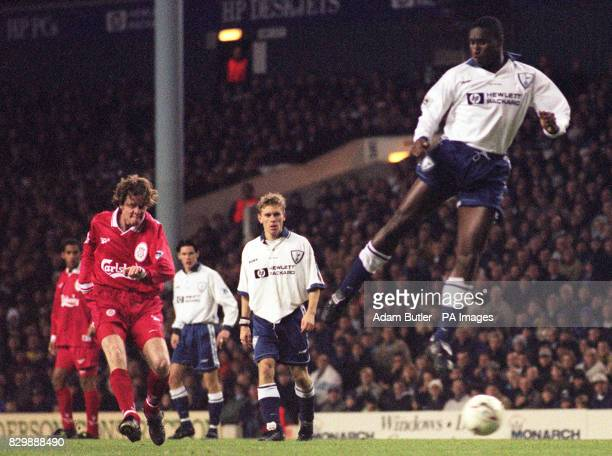 Allan Nielsen looks on as Steve McManaman scores Liverpool's second goal under the feet of Spur's Sol Campbell in tonight's Premiership clash at...