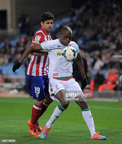 Allan Nyom of Granada CF shields the ball from Diego Costa of Club Atletico de Madrid during the La Liga match between Club Atletico de Madrid and...