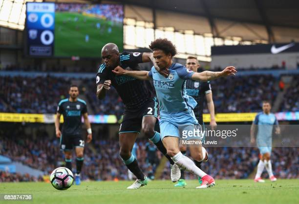 Allan Nyom of West Bromwich Albion and Leroy Sane of Manchester City battle for possession during the Premier League match between Manchester City...