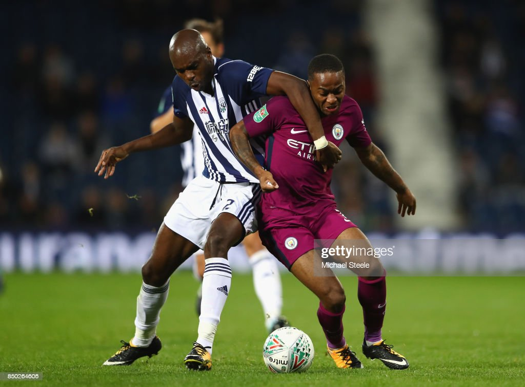 Allan Nyom of West Bromwich Albion and Raheem Sterling of Manchester City battle for possession during the Carabao Cup Third Round match between West Bromwich Albion and Manchester City at The Hawthorns September 20, 2017 in West Bromwich, England.