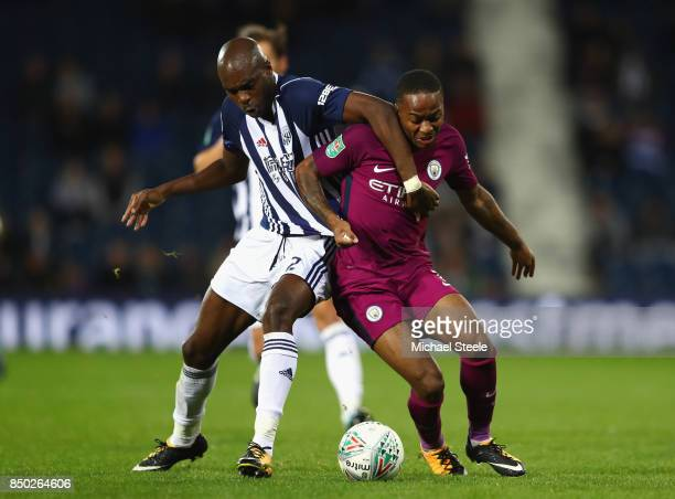 Allan Nyom of West Bromwich Albion and Raheem Sterling of Manchester City battle for possession during the Carabao Cup Third Round match between West...