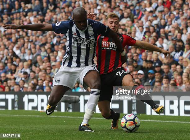 Allan Nyom of West Bromwich Albion is challenged by Ryan Fraser of AFC Bournemouth during the Premier League match between West Bromwich Albion and...
