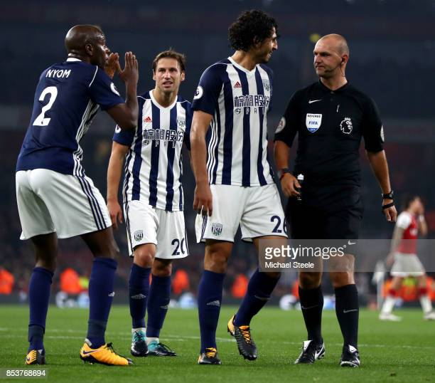Allan Nyom of West Bromwich Albion reacts as referee Robert Madley awards a penaltyduring the Premier League match between Arsenal and West Bromwich...