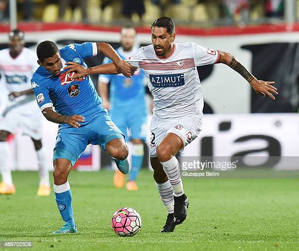Allan of Napoli and Marco Borriello of Carpi in action during the Serie A match between Carpi FC and SSC Napoli at Alberto Braglia Stadium on...