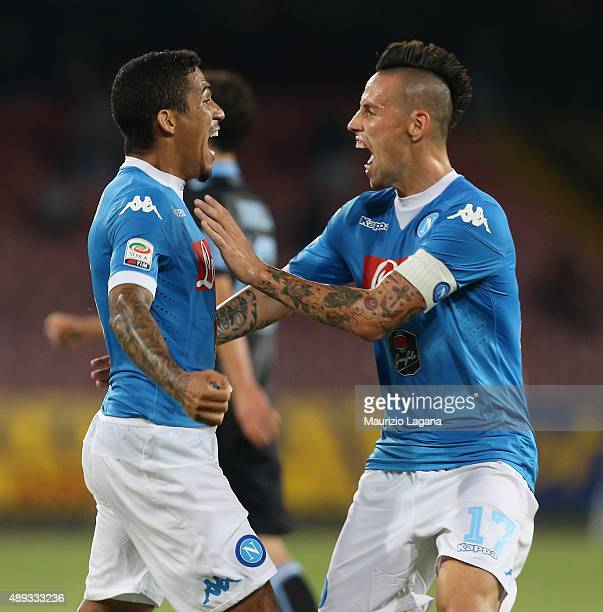 Allan of Napoli celebrates the second goal with his teammate Marek Hamsik during the Serie A match between SSC Napoli and SS Lazio at Stadio San...