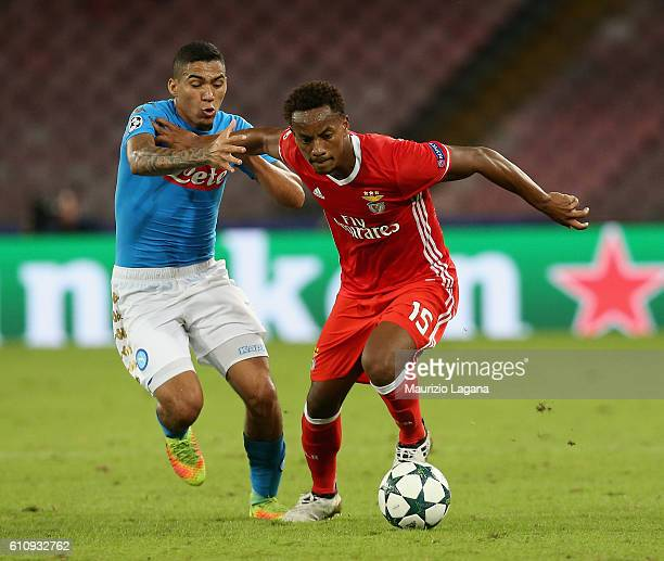 Allan of Napoli competes for the ball with Andrè Carrillo of Benfica during the UEFA Champions League match between SSC Napoli and Benfica at Stadio...