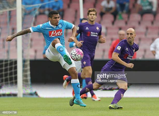 Allan of Napoli competes for the ball with Borja Valero of Fiorentina during the Serie A match between SSC Napoli and ACF Fiorentina at Stadio San...