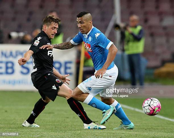 Allan of Napoli competes for the ball with Emanuele Giaccherini of Bologna during the Serie A match between SSC Napoli and Bologna FC at Stadio San...