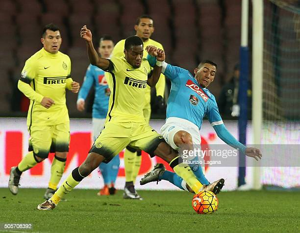 Allan of Napoli competes for the ball with Geoffrey Kondgbia of Inter during the TIM Cup match between SSC Napoli and FC Internazionale Milano at...