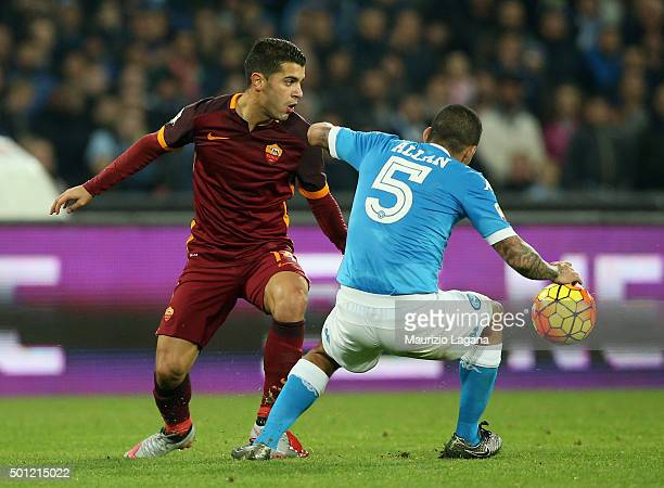Allan of Napoli competes for the ball with Iago Falque of Roma during the Serie A match betweeen SSC Napoli and AS Roma at Stadio San Paolo on...