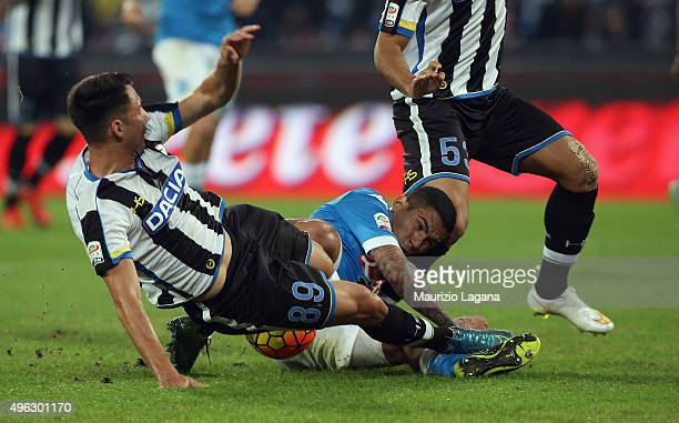Allan of Napoli competes for the ball with Ivan Piris of Udinese during the Serie A match between SSC Napoli and Udinese Calcio at Stadio San Paolo...