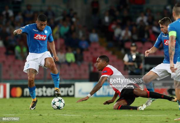Allan of Napoli competes for the ball with Jean Paul Boetius of Feyenoord during the UEFA Champions League group F match between SSC Napoli and...