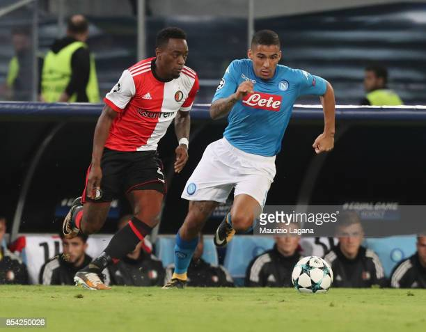 Allan of Napoli competes for the ball with Jeremiah St Juste of Feyenoord during the UEFA Champions League group F match between SSC Napoli and...