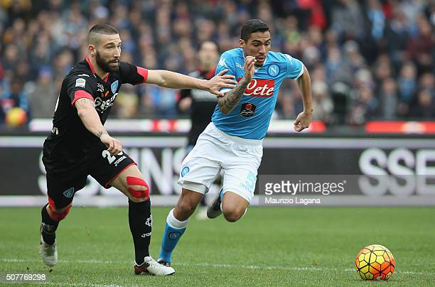 Allan of Napoli competes for the ball with Lorenzo Tonelli of Empoli during the Serie A match between SSC Napoli and Empoli FC at Stadio San Paolo on...