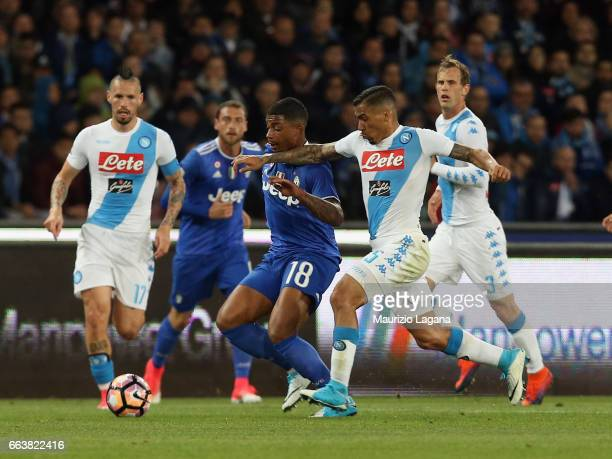 Allan of Napoli competes for the ball with Mario Lemina of Juventus during the Serie A match between SSC Napoli and Juventus FC at Stadio San Paolo...