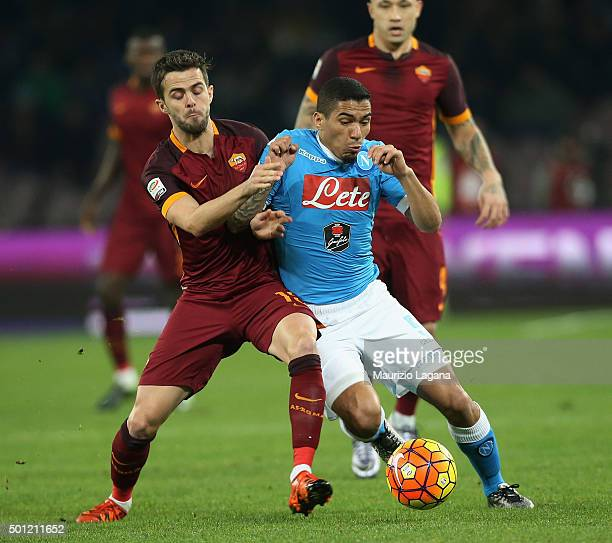 Allan of Napoli competes for the ball with Miralem Pjanic of Roma during the Serie A match betweeen SSC Napoli and AS Roma at Stadio San Paolo on...
