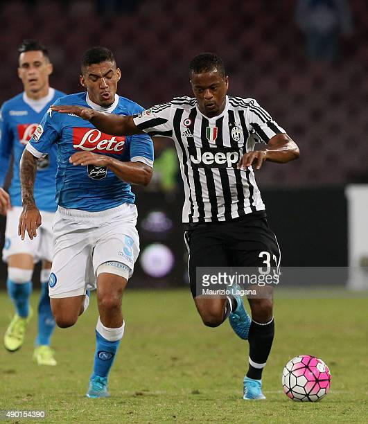 Allan of Napoli competes for the ball with Patrick Evra of Juventus during the Serie A match between SSC Napoli and Juventus FC at Stadio San Paolo...