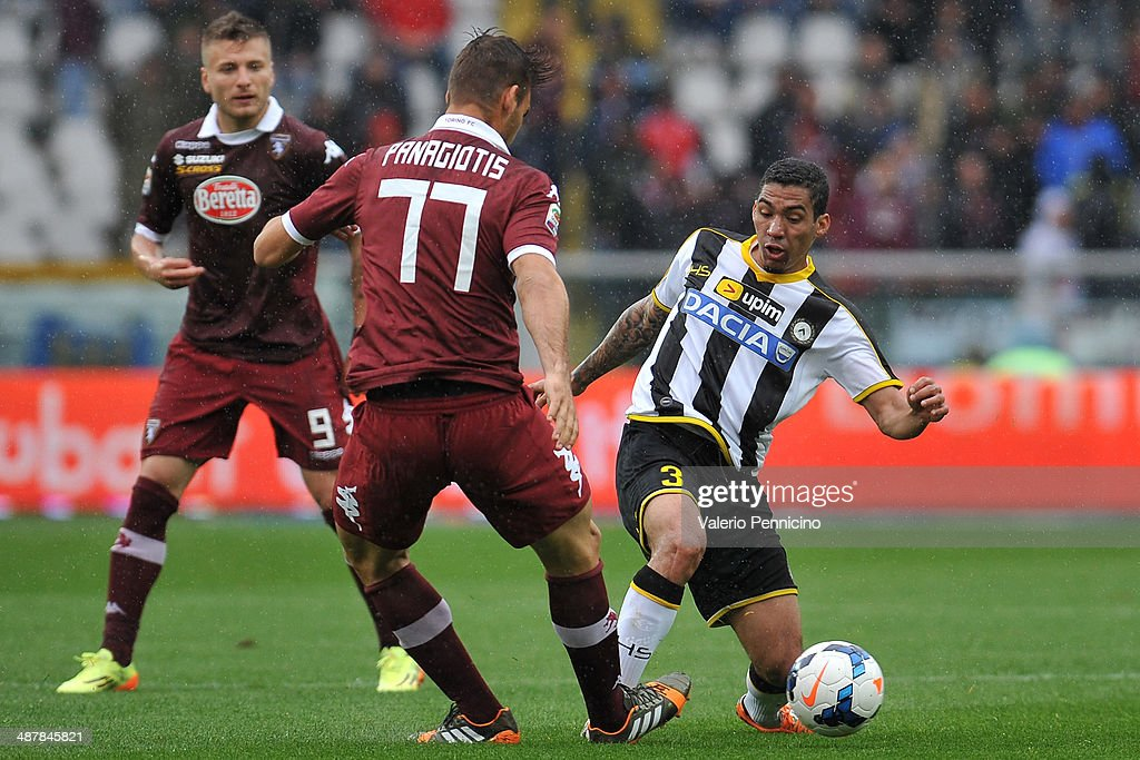 Allan (R) of Udinese Calcio tackles <a gi-track='captionPersonalityLinkClicked' href=/galleries/search?phrase=Panagiotis+Tachtsidis&family=editorial&specificpeople=6240627 ng-click='$event.stopPropagation()'>Panagiotis Tachtsidis</a> of Torino FC during the Serie A match between Torino FC and Udinese Calcio at Stadio Olimpico di Torino on April 27, 2014 in Turin, Italy.
