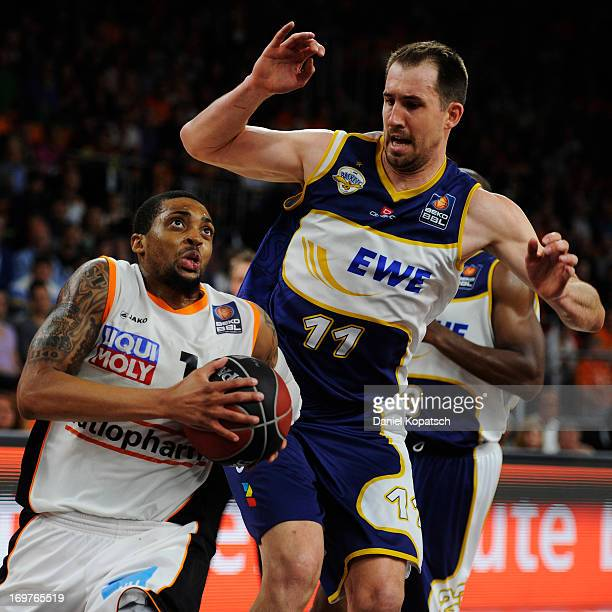 Allan Ray of Ulm is challenged by Adam Chubb of Oldenburg during the fourth Game of the semifinals of the Beko Basketball Playoffs match between...