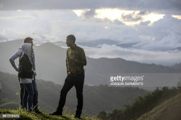 TOPSHOT Allan Rushell and his wife Amanda and Helio Neto R Brazilian players survivors of the air crash in Colombia last November visit the spot of...