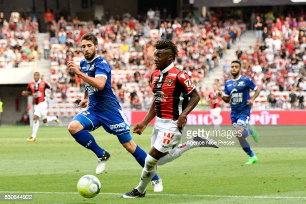 Allan Saint Maximin of Nice and Mathieu Deplagne of Troyes during the Ligue 1 match between OGC Nice and Troyes Estac at Allianz Riviera on August 11...