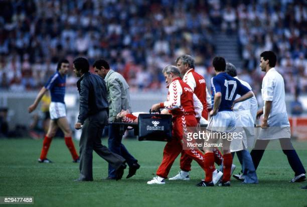 Allan Simonsen of Denmark leave the pitch is injured during the European Championship match between France and Denmark at Parc des Princes Paris...