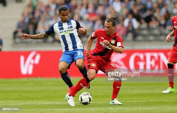 Allan Souza of Berlin battles for the ball with Julian Baumgartlinger of Leverkusen during the Bundesliga match between Hertha BSC and Bayer 04...