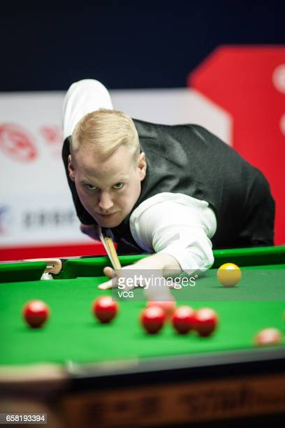 Allan Taylor of England plays a shot against Shaun Murphy of England on day one of 2017 China Open at Peking University Students Gymnasium on March...