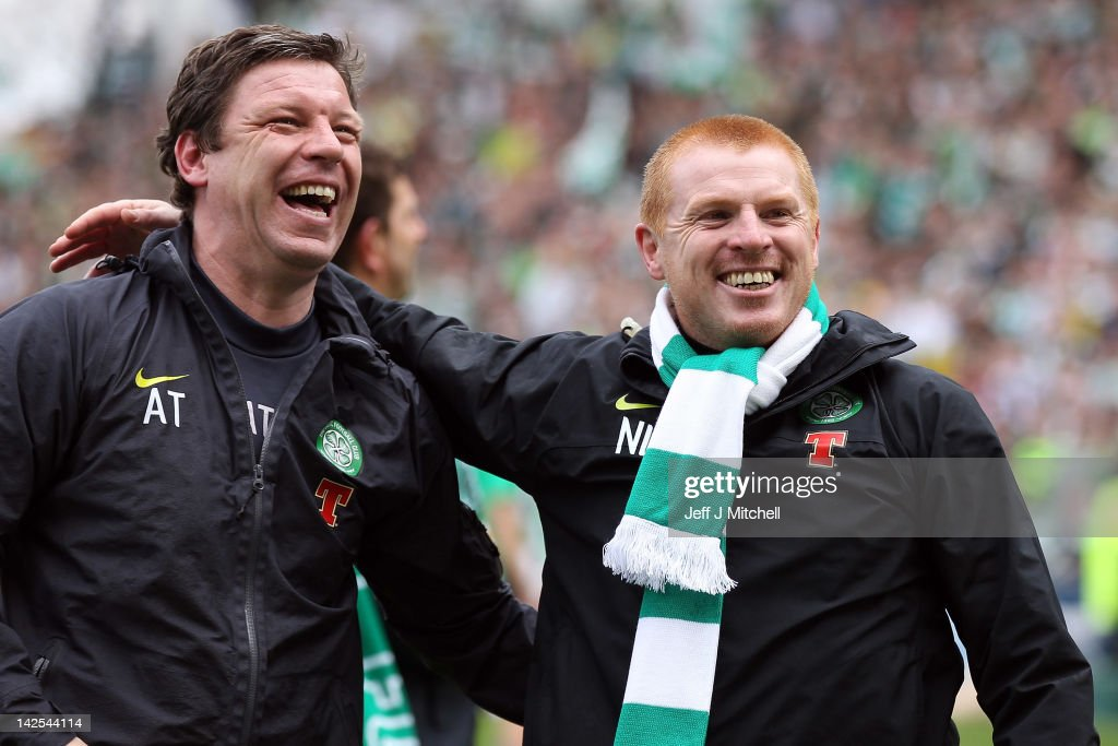 Allan Thompson and Coach <a gi-track='captionPersonalityLinkClicked' href=/galleries/search?phrase=Neil+Lennon&family=editorial&specificpeople=642944 ng-click='$event.stopPropagation()'>Neil Lennon</a> of Celtic celebrate following his team clinching the Scottish Clydesdale Bank Scottish Premier League title afterthe match between Kilmarnock and Celtic at Rugby Park on April 7, 2012 in Kilmarnock, Scotland.