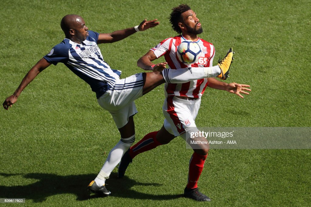 Allan-Romeo Nyom of West Bromwich Albion and Eric Maxim Choupo-Moting of Stoke City during the Premier League match between West Bromwich Albion and Stoke City at The Hawthorns on August 27, 2017 in West Bromwich, England.