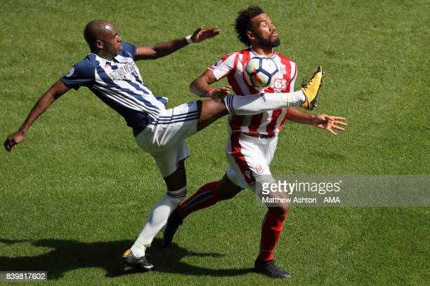 AllanRomeo Nyom of West Bromwich Albion and Eric Maxim ChoupoMoting of Stoke City during the Premier League match between West Bromwich Albion and...