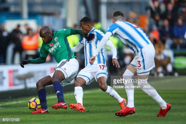AllanRomeo Nyom of West Bromwich Albion and Rajiv Van La Parra of Huddersfield Town during the Premier League match between Huddersfield Town and...