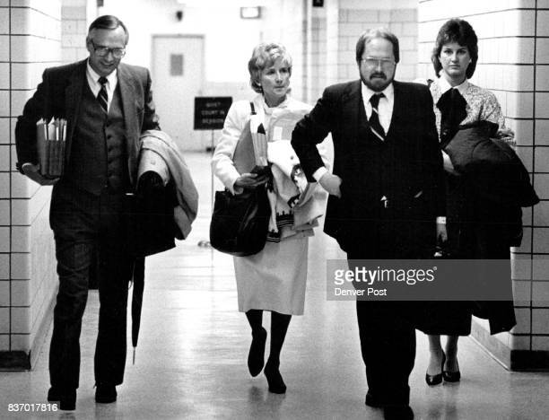 Alledged witch Jan Cole leaves Adams County District Court with attorney William Bethke and supporters after the days testimony in her case versus...
